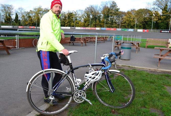 ©Barry Sandland/TIMB - Coach w his bike at Herne Hill velodrome