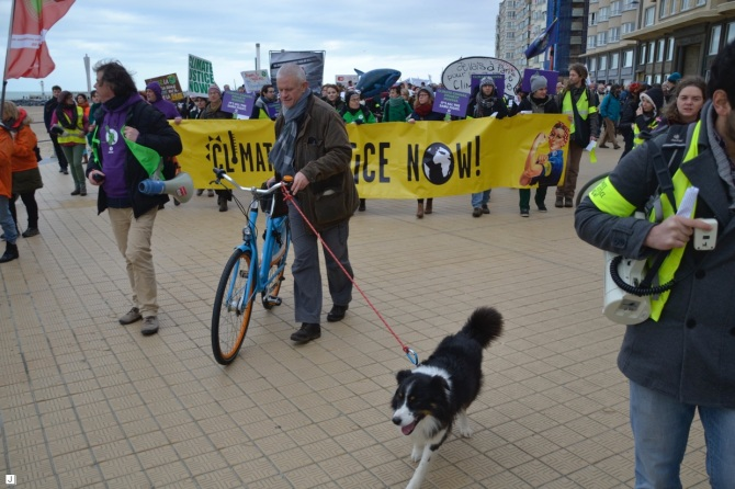 ©Barry Sandland/TIMB - Man walking his dog at the COP21 march in Ostende