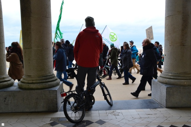 ©Barry Sandland/TIMB - Man w foldable bike watching the climate change protest in Ostend, Belgium