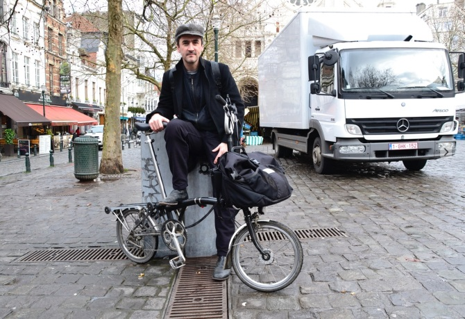 ©Barry Sandland/TIMB - Man  with Brompton folding bike in Brussels