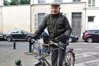 ©Barry Sandland/TIMB - Man with his old bike in Brussels
