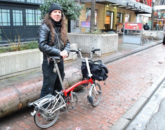 ©Barry Sandland/TIMB - Theatre worker w his Brompton folding bike