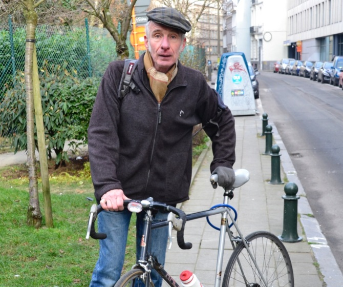 ©Barry Sandland/TIMB Man w his bike in Brussels
