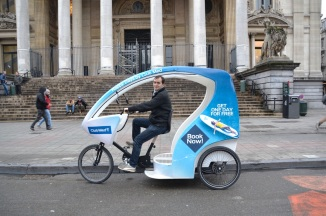 ©Barry Sandland/TIMB - Velotaxi at one of the tourist hubs of Brussels
