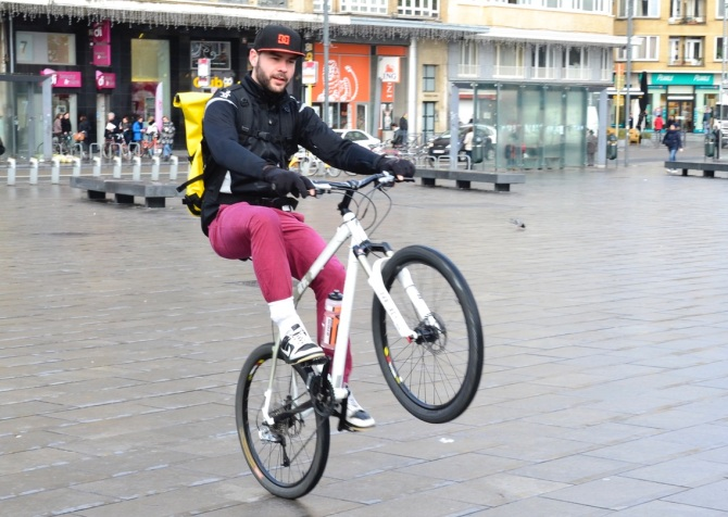 ©Barry Sandland/TIMB - Bicycle messenger doing wheelies in Place Flagey