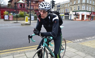 ©Barry Sandland/TIMB - Man on his Bianchi bike in Brixton