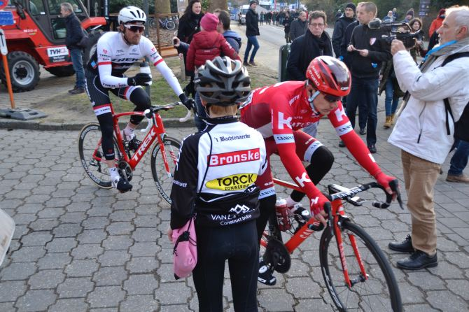 ©Barry Sandland/TIMB - Young rider asking for water bottles from riders at Oomloop het Nieuwsblad