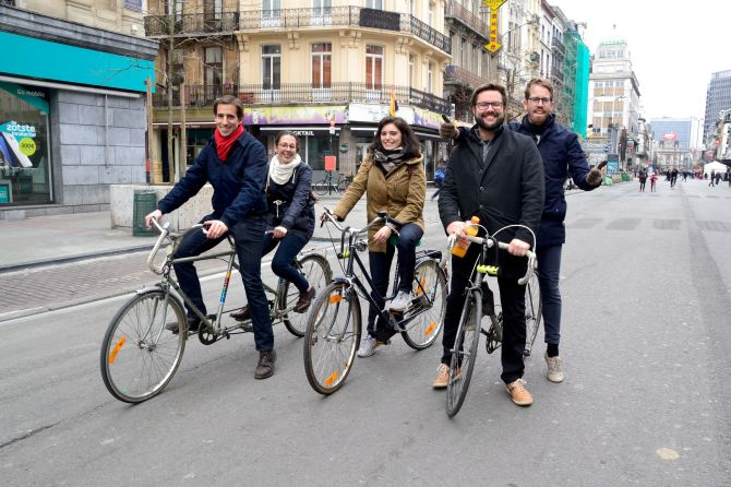 ©Barry Sandland/TIMB - Five cyclists together in Brussels with just four bikes.