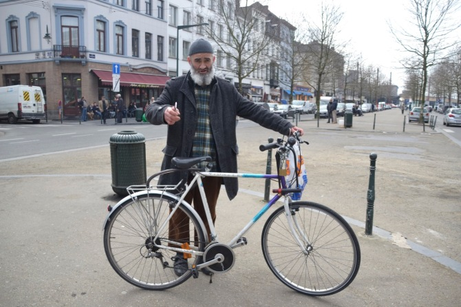 ©Harry Sandland/TIMB - Muslim man and his bike in Brussels