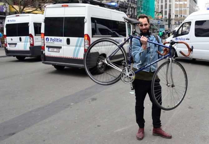 ©Barry Sandland/TIMB - Man w his father's vintage Scxanini bicycle at the football violence in Brussels
