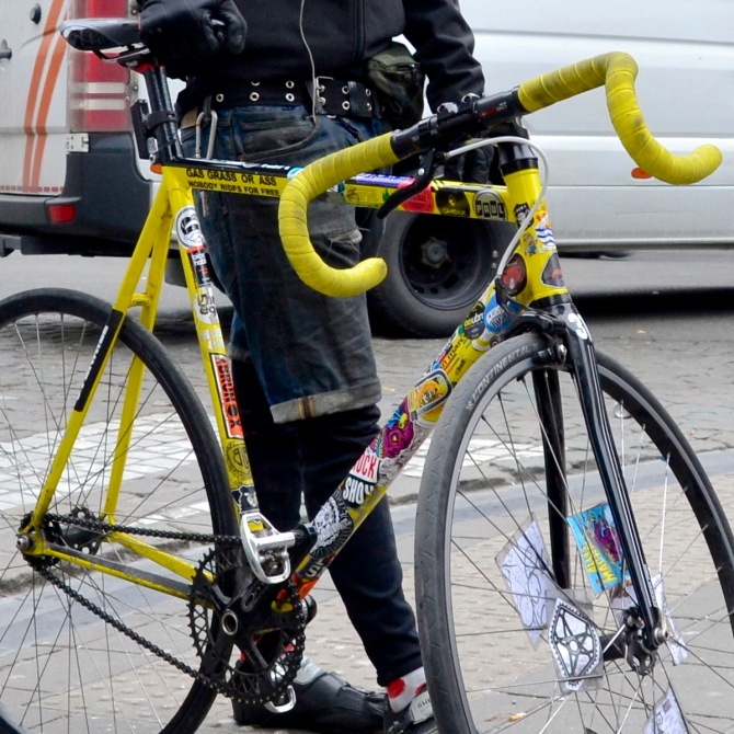 ©Barry Sandland/TIMB - Bike messenger w his yellow bike