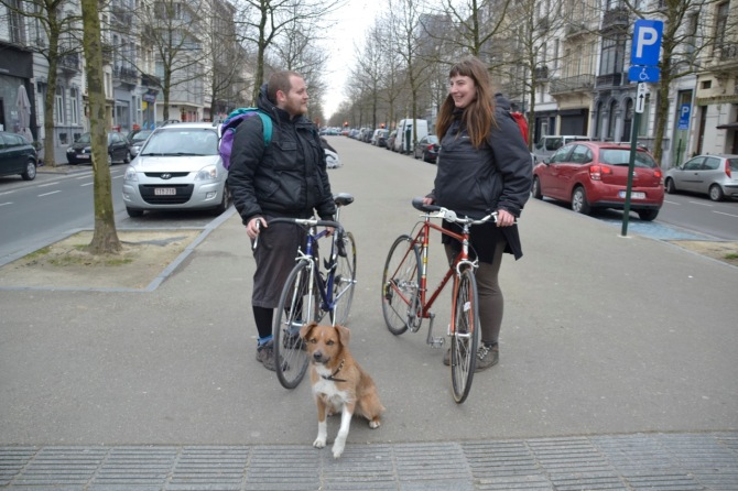 ©Barry Sandland/TIMB - Couple w their dog, riding bikes in Brussels