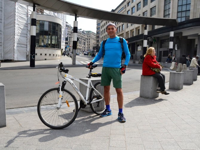 ©Barry Sandland/TIMB - Cyclist w his B-twin mountain bike in from of Gare Centrale, Brussels