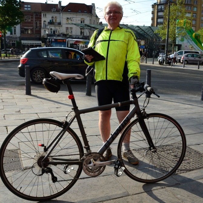 ©Barry Sandland/TIMB - Man with his affordable hybrid bicycle in Brussels