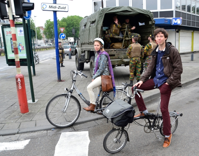 ©Barry Sandland/TIMB - Two transit strike cyclists with a military vehicle and staff in the background