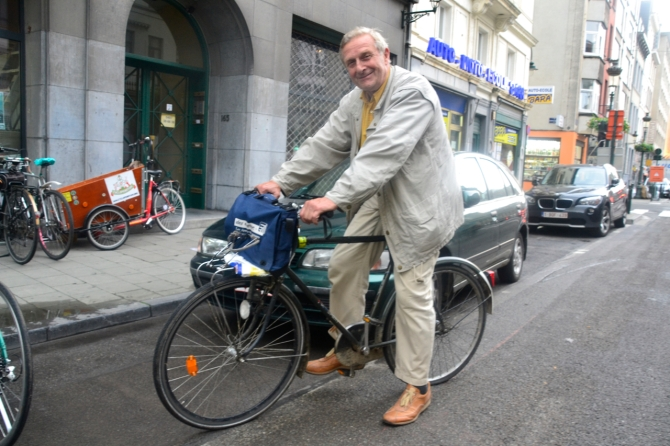 ©Barry Sandland/TIMB - Man with his old clunker bicycle, joking about avoiding bike theft, in Brussels