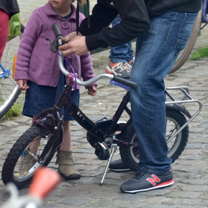 ©Barry Sandland/TIMB - Toddler getting her first bike through Cyclo