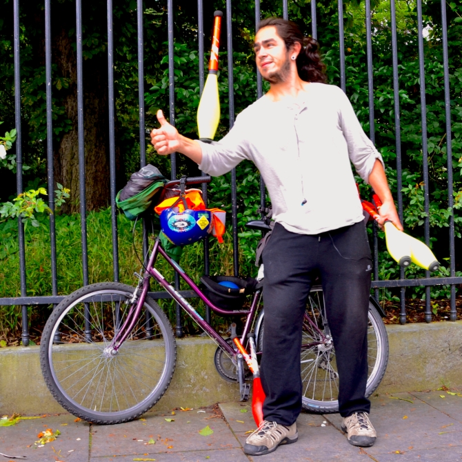 Barry Sandland/TIMB - Street performer and his bike in Brussels