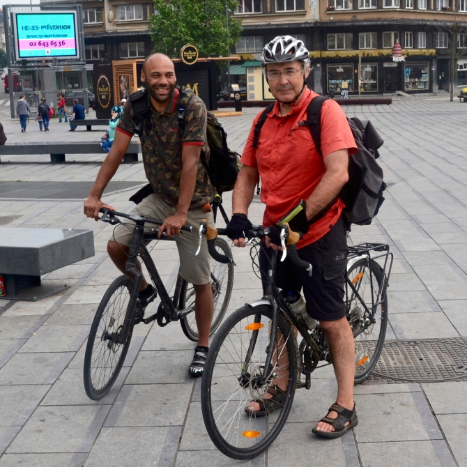 ©Barry Sandland/TIMB - Two Take, Eat, Easy delivery riders meeting at Place Flagey in Brussels