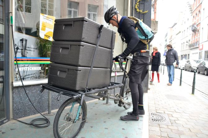 ©Barry Sandland/TIMB - bicycle messenger w a full load on his Omnium cargo bike