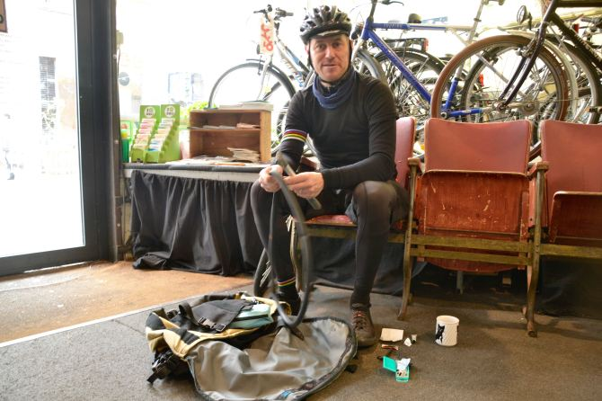 ©Barry Sandland/TIMB - Messenger rider repairing a puncture at the Cyclo shop