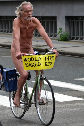 ©Barry Sandland/TIMB - Man on his bike participating in the World Naked Bike Ride day