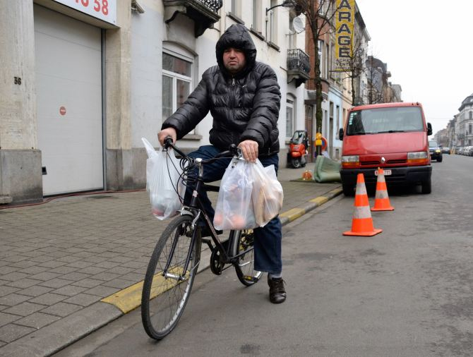 ©Barry Sandland/TIMB - Man carrying groceries on his bicycle