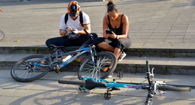 ©Barry Sandland/TIMB - Couple sharing social media on a bike ride