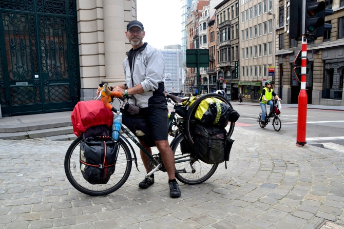 ©Barry Sandland/TIMB - North American touring cyclist w his bike in Brussels
