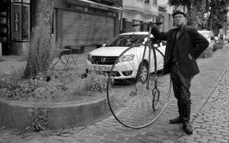 ©Barry Sandland/TIMB - Man with pennyfartthing bicycle in Brussels