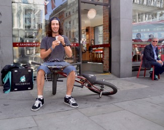 ©Barry Sandland/TIMB - Deliver messenger cyclist at a coffee shop in London