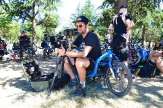 ©Barry Sandland/TIMB - Documentary filmmaker w his Bullitt bike, preparing for the day shoot w Bullitt bikes