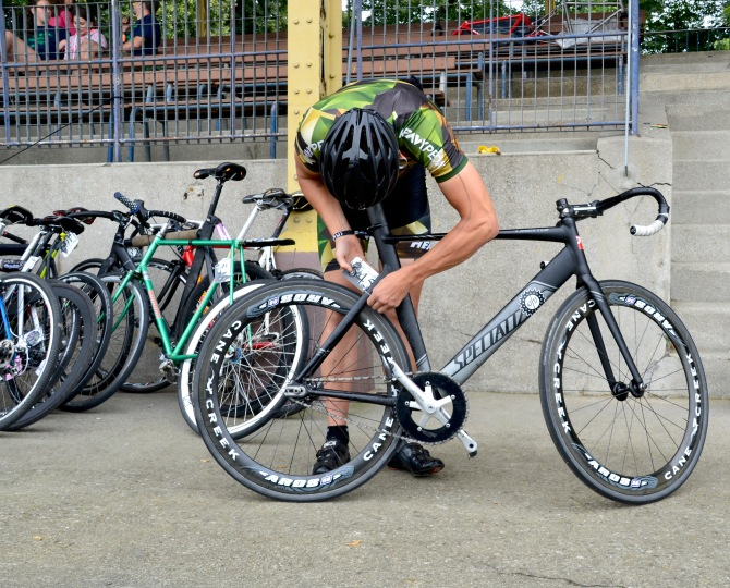 ©Barry Sandland/TIMB - Messenger rider preparing his bike for the track ride