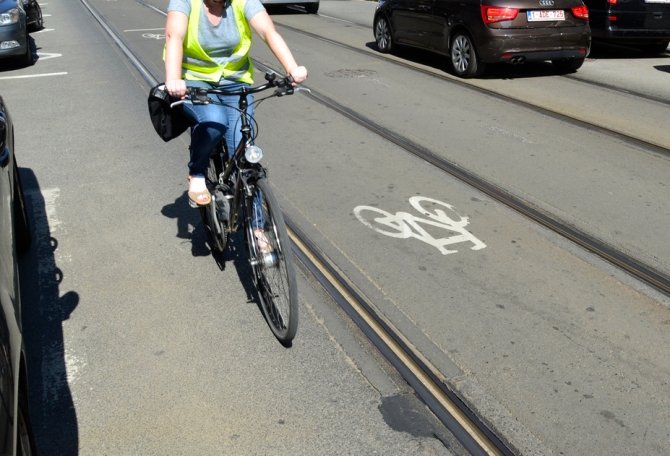 ©Barry Sandland/TIMB - Cyclists near the bike path designated inside a tram track sysem
