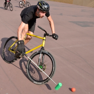 Barry Sandland/TIMB - Bike polo rider in a breakaway ride w the ball.