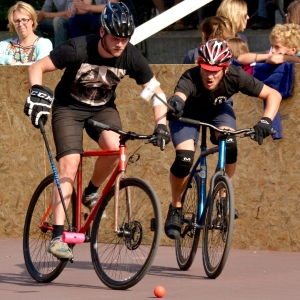 Barry Sandland/TIMB - Two riders competing for the ball in bike polo