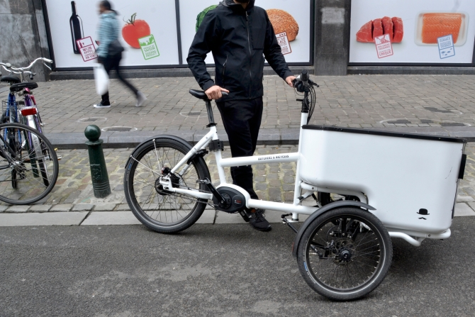 ©Barry Sandland/TIMB - Butcher and bicycles cargo bike outside the supermarket in Brussels