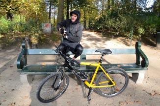©Barry Sandland/TIMB - Man on bike on a park bench with his mountain bike