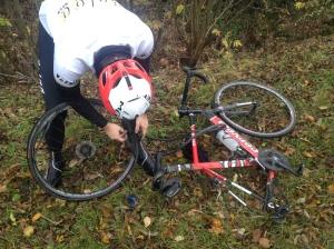 ©Barry Sandland/TIMB- Volga rider repairing his flat tire on a training ride