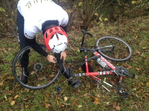 ©Barry Sandland/TIMB- Volga rider repairing his flat tire on a training ride