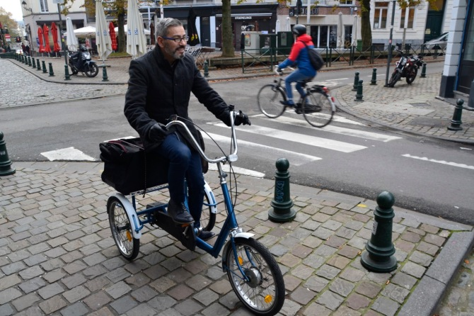 ©Barry Sandland/TIMB - Man on his tricycle own the streets in Brussels