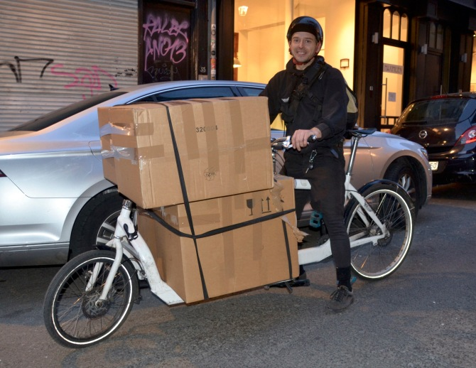 ©Barry Sandland/TIMB - Courier w his overloaded cargo bike