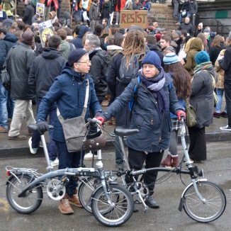 ©Barry Sandland/TIMB - Two women w their Bromptron bicycles at the anti-ban demonstration in Brussels