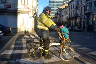 ©Barry Sandland/TIMB - Rider dressed for cold weather w his folding bike