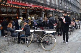 ©Barry Sandland/TIMB - Bicycle at a frites location and a queue of people