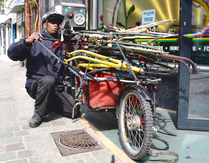 ©Barry Sandland/TIMB - CYCLO mechanic preparing a cargo bike w abandoned frames