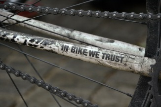 ©Barry Sandland/TIMB - Bumber sticker on a bicycle reads, In Bike We Trust.
