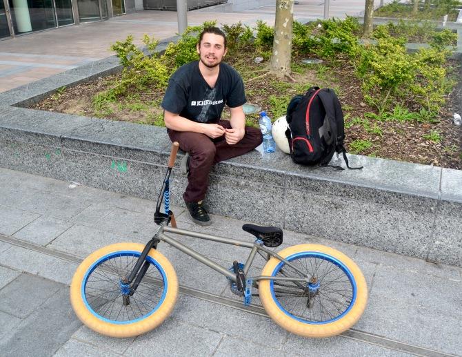 ©Barry Sandland/TIMB - BMX rider w his bike resting at the EU Parliament esplanade