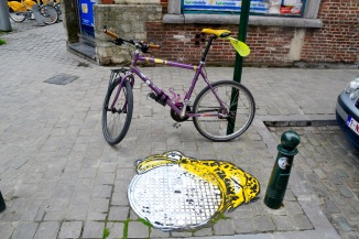 ©Barry Sandland/TIMB - My bike r4esting next to one of the Oakoak street art pieces in Brussels