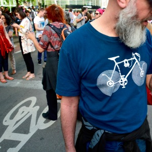 ©Barry Sandland/TIMB - Man wearing a cycling t-shirt at the Trump protest march in Belgium